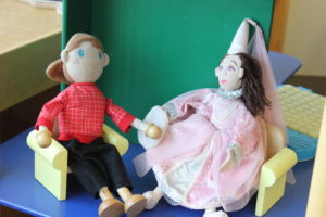 Two dolls in a chair