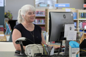 A staff member at the circulation desk