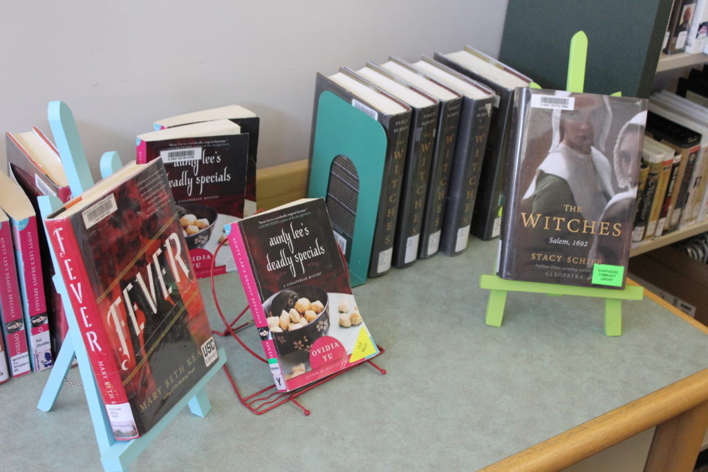 Staff book picks on a table